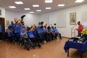 celebració ascens dins la sala d'actes